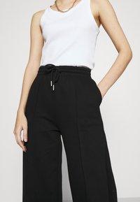Gina Tricot - BONNIE - Teplákové kalhoty - black - 3