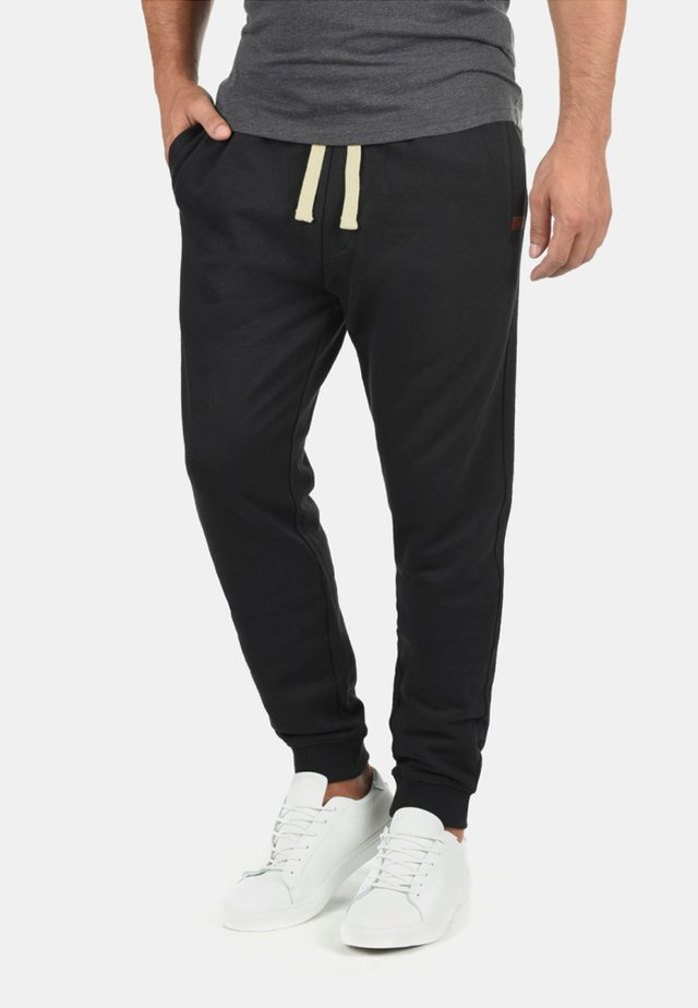 REGULAR FIT - Trainingsbroek - black