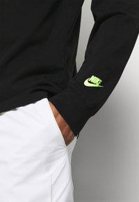 Nike Performance - TEE CHALLENGE - Long sleeved top - black - 5