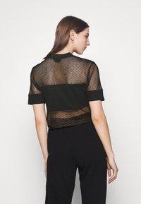Fila - NIVEO CROPPED - Print T-shirt - black - 2