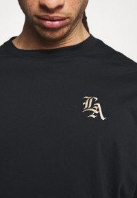 Nike Performance - T-shirt med print - black - 4
