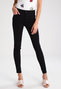 Vero Moda - VMSEVEN - Trousers - black - 0