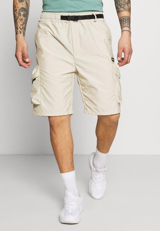 MARATHON - Shorts - camel