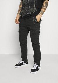 Tigha - FRYCO - Cargo trousers - vintage black - 3