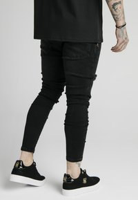 SIKSILK - DISTRESSED  WITH ZIP DETAIL - Jeans Skinny Fit - washed black - 2