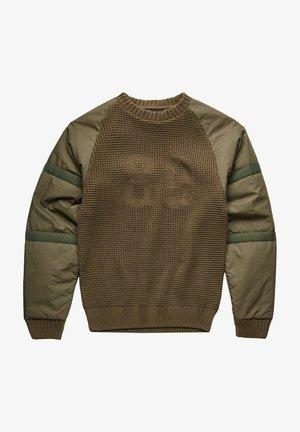 Stickad tröja - combat