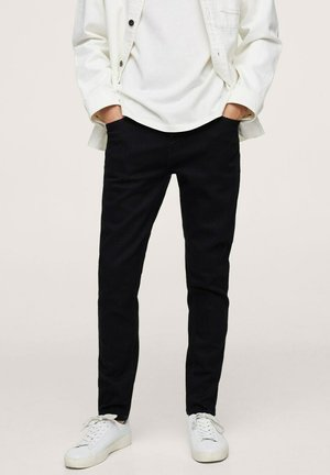 TOM AUS  - Jeans Tapered Fit - black denim