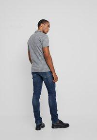 AllSaints - CIGARETTE DAMAGED - Slim fit jeans - indigo - 2