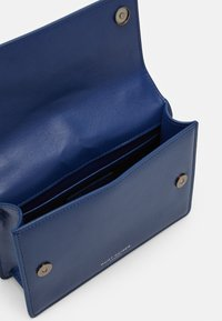 Kurt Geiger London - SHOREDITCH CROSS BODY - Across body bag - blue dark