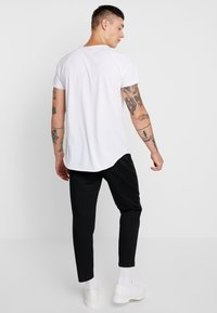 Mennace - TAPERED  - Chino - black - 2