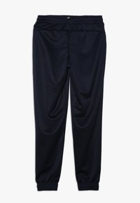 Puma - LOGO PANTS - Tracksuit bottoms - peacoat - 1