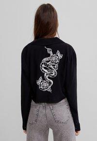 Bershka - MIT PRINT  - Button-down blouse - black - 2