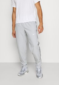 Nike Performance - RUN STRIPE PANT - Tracksuit bottoms - light smoke grey/smoke grey/reflective silver - 0
