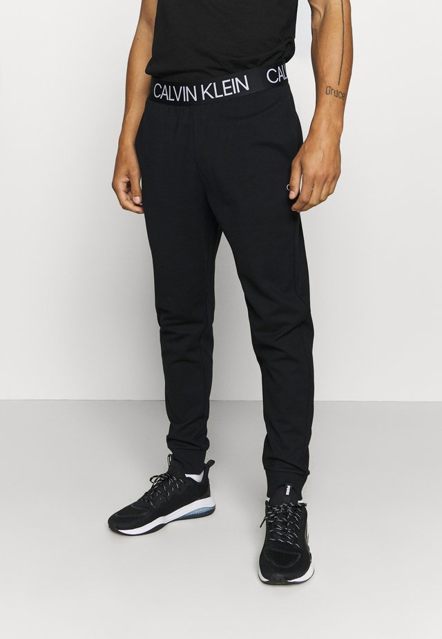 PANTS - Pantalon de survêtement - black