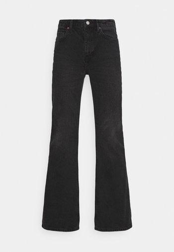 FLARE - Flared Jeans - washed black