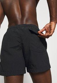 Champion - Swimming shorts - black - 2