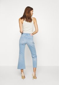 Calvin Klein - HIGH RISE SKINNY  - Široké džíny - light-blue denim - 2