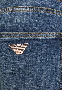 Emporio Armani - 5 POCKETS PANT - Slim fit jeans - blue denim - 5
