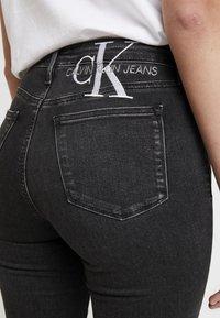 Calvin Klein Jeans - HIGH RISE - Skinny džíny - ca043 black - 5