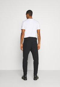 AllSaints - JAVAN - Trousers - blue - 2