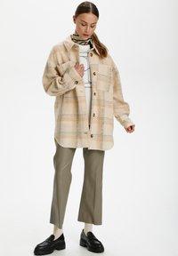 Soaked in Luxury - Short coat - sandshell check - 1