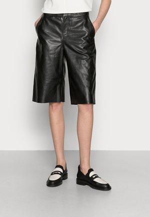 JOYCE - Leather skirt - black