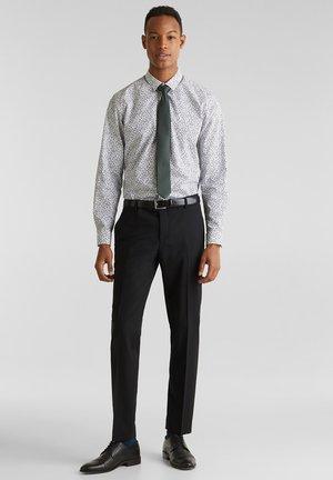 ACTIVE - Oblekové kalhoty - black