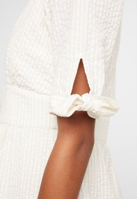 Vero Moda - VMMILA CALF DRESS - Shirt dress - snow white/oatmeal - 6