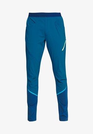 TRANSALPER HYBRID - Spodnie materiałowe - mykonos blue
