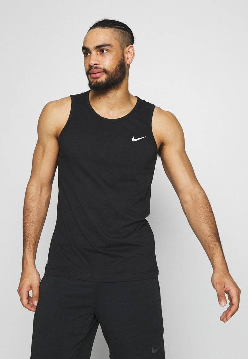 Nike Performance - DRY TANK SOLID - T-shirt de sport - black /white