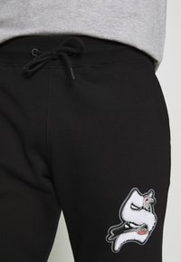 STAPLE PIGEON - UNISEX - Tracksuit bottoms - black - 5