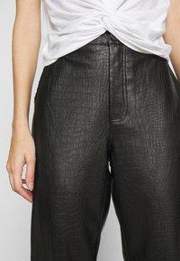 Vila - VIPIPPA COATED DETAIL PANTS - Trousers - black - 3