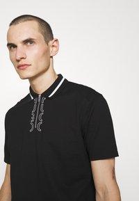 HUGO - DOLMAR - Polo shirt - black - 3