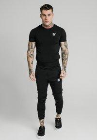 SIKSILK - AGILITY TRACK PANTS - Tracksuit bottoms - black - 0