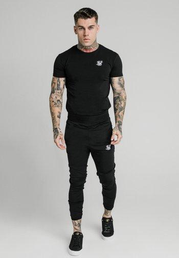 AGILITY TRACK PANTS - Tracksuit bottoms - black