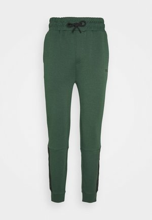 OMER PANTS - Tracksuit bottoms - sycamore