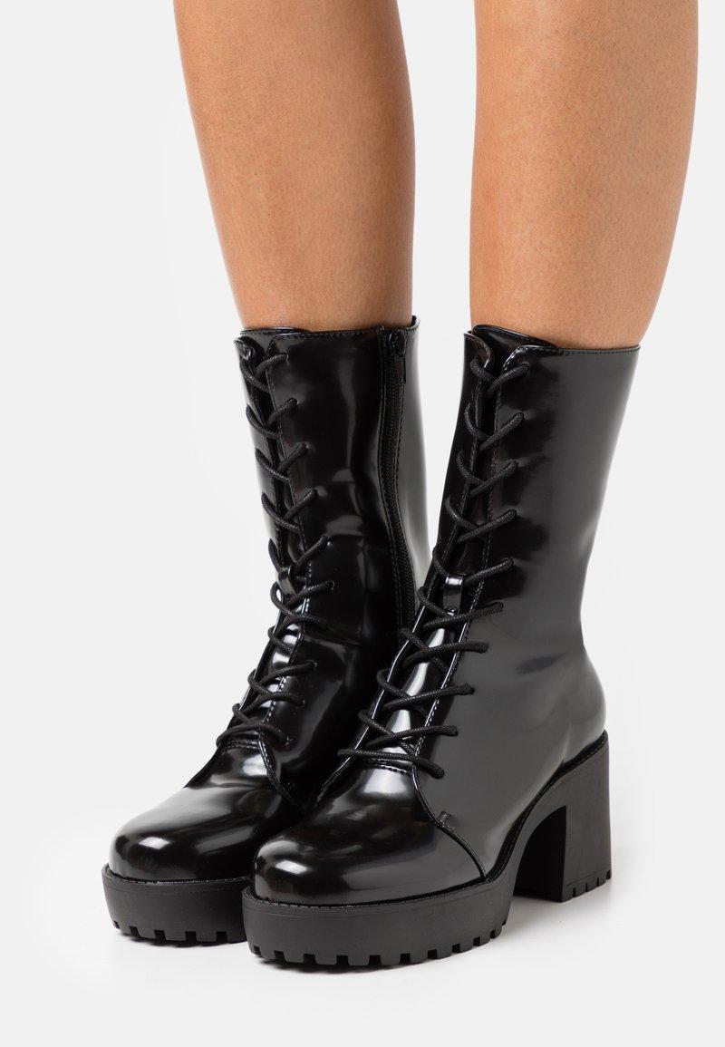 Monki - Platform ankle boots - black