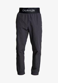Calvin Klein Performance - TRACK PANTS - Spodnie treningowe - gunmetal/black - 5