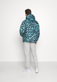 Lacoste - LACOSTE X NATIONAL GEOGRAPHIC - Winter jacket - frog/abysm - 2