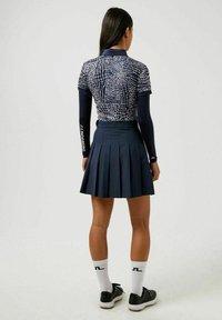 J.LINDEBERG - Sports skirt - jl navy - 2
