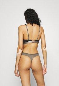 Calvin Klein Underwear - SHEER MARQUEISETTE THONG - String - platinum grey - 0