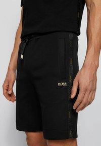 BOSS - HEADLO  - Tracksuit bottoms - black - 3