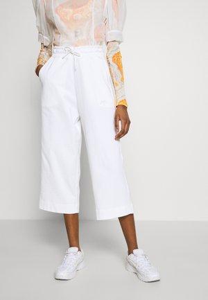 NSW CAPRI JRSY - Spodnie treningowe - white
