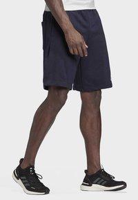 adidas Performance - MUST HAVES BADGE OF SPORT SHORTS - Short de sport - blue - 2