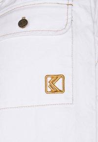 Karl Kani - RETRO BAGGY PANTS - Trousers - white - 2