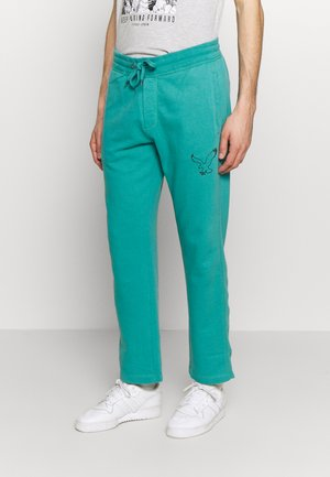 RELAXED - Tracksuit bottoms - camper green