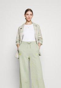 Nike Sportswear - PANT - Tracksuit bottoms - olive aura - 3