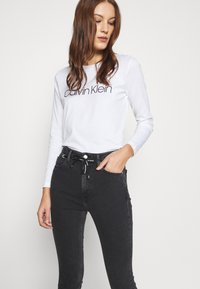 Calvin Klein Jeans - HIGH RISE SKINNY - Jeans Skinny Fit - black with eyelet - 3