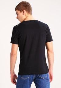 Calvin Klein Jeans - TREASURE - Print T-shirt - black - 2