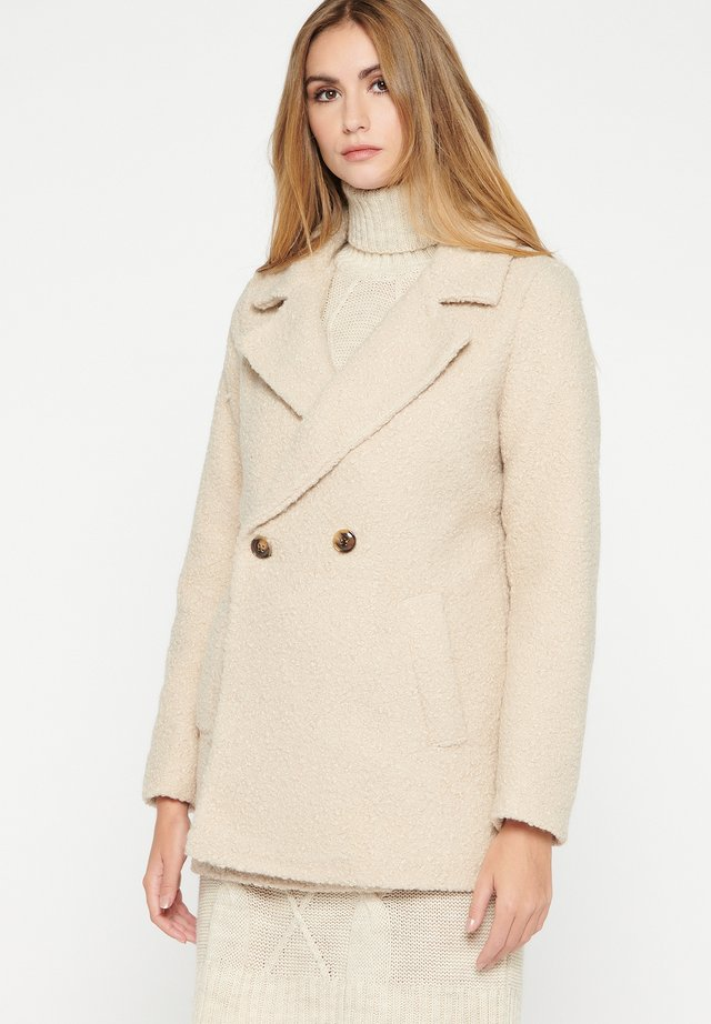 Abrigo corto - beige